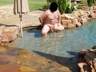 My hubby is nervously posing nude for me in our pool!  The neighbor lady and her female friends were in her backyard and had a perfect view of him had they paid attention!