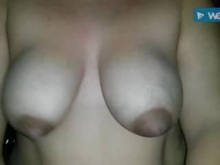 Horny wife satisfied by husband pre-xmas! She loves riding him hard and loves her big natural boobies satisfying her husband.