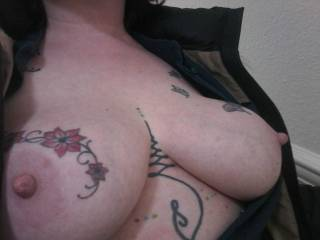 Out and about with Sally is always fun... coat on but open to expose her breasts!