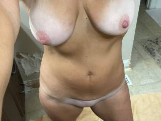 Naked selfie before heading out to the swinger club. Want to run into me at the club? I enjoyed being totally naked there and uninhibited!