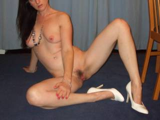 Beautiful tits and gorgeous pussy too.  Love the sexy CFM heels too.  Very hot pic.