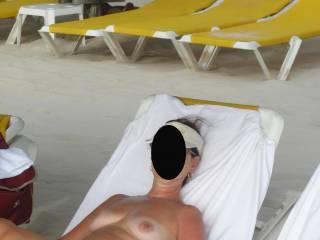 wife enjoying the beach