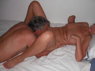 Our swinger friend eats out my pussy, when he came around again for a threesome.