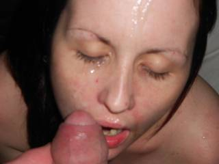 love seeing her face covered in sperm!  She needs my load of thick white cum too!!!