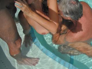 Threesome fun in the swimming pool at home, when our swinger friend came around for some fun.