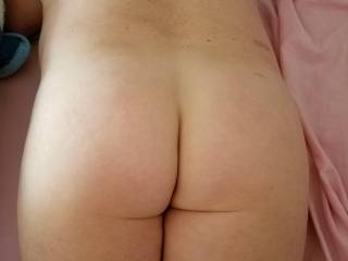 Her amazing ass!!! I looooove playing with it and burying my tongue deep inside of it!!!