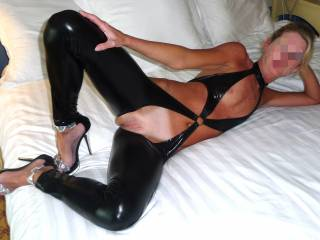 Honey, I'm always feeling naughty.  I would love to be right there in that bed with you, and have 10 men standing around in a circle watching us doing each other, and driving them nuts. By the way, I love those shoes.