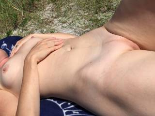 She loves to be nude at the beach.  I love it when pople pass by and see her lovely body nude