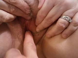 Sliding some fingers in to that snatchbox. It did not take long for Mrs. Shutterbug58 to start moaning and groaning. After marinating my fingers that lovely pussy, I sucked her pussy juice off of my fingers. Mmm... Finger licking good!