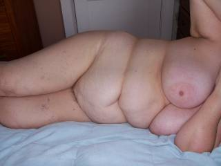 Love her gorgeous body, she has beautiful big tits and that soft belly is so sexy.
