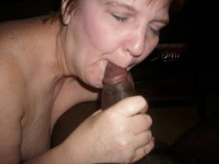 She looks hot sucking that cock.