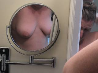 Walking by the bathroom, I saw a photo op that turned out better than I expected. I was hoping to catch a nice full view of her breasts in the large mirror but unexpectedly got an artsy shot in the small mirror. Made me happy!!!
