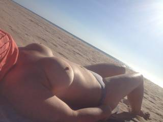 catching some sun at the nude beach, caught a few old men having a perv too